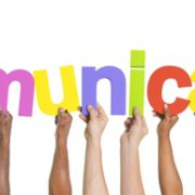 Multiethnic Arms Raised Holding Word Communication